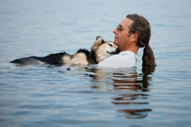 man-in-lake-with-dog